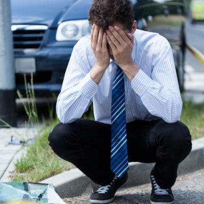 Elegant man crying at accident scene, vertical